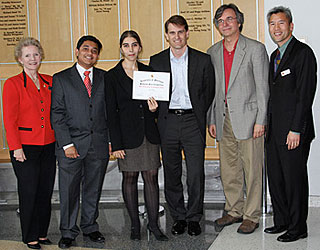 The FlexEl Team receives their first place award, from left to right: Karen Thornton, Josekuttan Manikathuparambil, Zeynep Dilli, Karl Renner, Neil Goldsman, and Dean Chang. Photo by Eric Schurr.