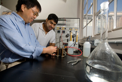 Assistant Professor Chunsheng Wang (left) works with graduate student and recent alumnus Kunal Pandit (B.S. '09) in the Department of Chemical and Biomolecular Engineering's upgraded Unit Operations Lab.