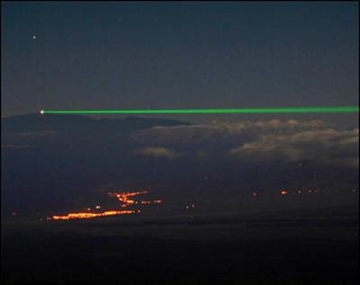 "A laser beam sent over 149 km (more than 93 miles) from Mauna Loa on the big island of Hawaii to Mount Haleakala on Maui during summer 2009 as part of the Coherent Optical Multi Beam Atmospheric Testbed project. The bright spot to the left is the 3.6-meter aperture of the Air Force telescope—the laser beam's destination point. Vorontsov writes: ""It is a good example of beauty and excitement of science we should somehow manage to pass to our students."""