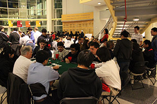 Students play poker for a chance to win door prizes at Casino Night. Photo by Justin Chen.