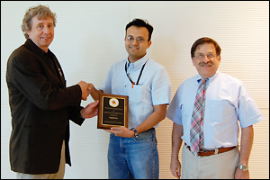 Left to right: MSE Professor and Chair Robert M. Briber, Parag Banerjee, and MSE Professor Gary Rubloff.