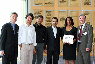 Dr. Dean Chang, Director of Mtech Ventures and Technology Advancement Program (far left) poses with Dr. Tarun Pruthi (center), Prof. Carol Espy-Wilson (second from right), and Warren Citrin (far right).