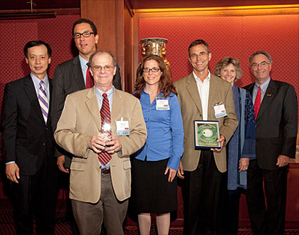 (Center, front row, from left to right) FlexEl award winners Prof. Martin Peckerar, Karina Drees, and Bob Proctor pose at the 2010 Maryland Incubator Company of the Year Awards ceremony in Baltimore, Md. Also pictured, back row, left to right: Benjamin Wu, Maryland Department of Business and Economic Development (DBED); Christian S. Johansson, secretary, Maryland DBED; Barbara Dreyer, president & CEO, Connections Academy®; John M. Wasilisin, acting president and executive director, TEDCO. Photo by Tracey Brown.