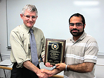 Prof. Patrick O'Shea (left) poses with Mohammed Eslami. Photo by Jess Molina.