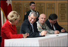 The CRADA Statement of Work document is signed by Norma Allewell, acting vice president of research, University of Maryland (far left); and Gary Blohm, director, Communications‐Electronics Research, Development, and Engineering Center (far right). Moments earlier, University of Maryland Acting President and Provost Nariman Farvardin (second from left); and RDECOM Commanding General, Major General Nick Justice (third from left) signed the CRADA agreement.