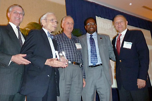 Professor Emeritus Joseph Silverman (second from left) is presented with IRaP's Lifetime Achievement Award by Clark School dean Darryll Pines (second from right) and MSE professor Mohamad Al-Sheikhly (far right).
