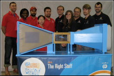 University of Maryland Students from the Smart Structures Laboratory in the Dept. of Aerospace Engineering with the newly refurbished open-circuit wind tunnel model. Front Row, Left to Right: Ami Powell (G), Min Mao (G), Erica Hocking (G), Andrew Becnel (G). Back Row, Left to Right: Nick Wilson (G), Harinder Singh (G), Shane Boyer (UG), Ben Woods (G), Prof. Norm Wereley, and Robbie Vocke (G). Absent: Ryan Robinson (G), and Chani Wereley (Intern).