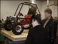 Dr. Vahdati ( left ) and Dr. Schultz at the SAE lab in front of the 2007 Mini-Baja car