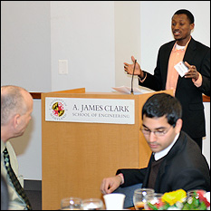 MSE Senior Olatunji Godo presenting his research at a dinner for L-3 scholars.