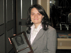 Varnika Roy with her award at the national meeting of the American Chemical Society.