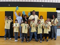 "Kathleen Frankle (pictured far right) poses with the Huntingtown Elementary School ""Heron-otics"" Lego Robotics Team"