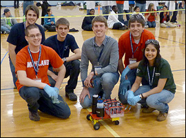 Team Thirsty Turtles at the Chem-E Car competition at Penn State in April 2011. Left to right: Bob Latimer (junior, Mechanical Engineering, back row), Kevin Bates (junior, ChBE, front row), Lucas Hedinger (junior, Electrical and Computer Engineering), Adam Gradzki (junior, ChBE), and Sandhya Patel (junior, ChBE). Not pictured: John Weston Breda (junior, ChBE), Whitney Hollinshead (junior, ChBE), Leslie Mok (junior, ChBE), and Brett Koller (junior, ChBE).