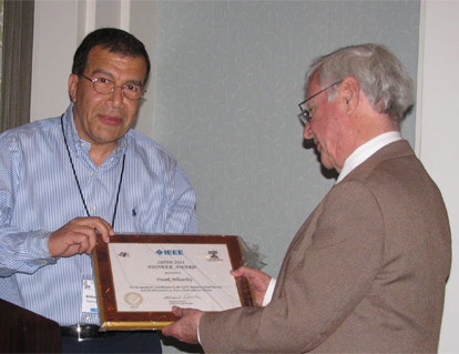 C. Frank Wheatley (right) was presented with the Pioneer Award from Dr. Mohamed Darwish (left), chairman of the IEEE convention, at the 23rd International Symposium on Power Semiconductor Devices & ICs on May 24, 2011, San Diego, CA. Photo by Tom Wheatley.