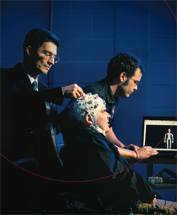 BioE affiliate professor José Contreras-Vidal (Department of Kinesiology, standing at left) working with graduate students Steven Graff (BioE, seated) and Alessandro Presacco (Department of Kinesiology, background) on a noninvasive brain-computer interface that could soon control sophisticated prosthetic devices. Photo by John Consoli.