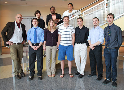 Professor Ray Phaneuf with the 2011 MSE senior Capstone Design team. Front row, left to right: Professor Ray Phaneuf, Nicholas Strnad, Tricia Alward, Robert Thompson, Coit Hendley, Iain Kierzewski, and William Schoenfelder. Back row, left to right: Michael Meadows, Tunji Godo, and Ninoska Moratin.