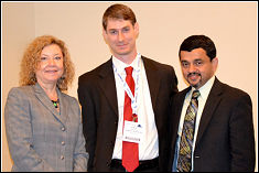 Andrew Becnel (center), with Dr. Kate Thorp, SAMPE Intl. Vice President,  and Dr. Allan Crasto, SAMPE Intl. President, after receiving the Jerry Bauer Award in May 2010.<br />