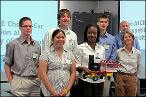 Team Thirsty Turtles at W.R. Grace Foundation's Columbia, Md. campus. Left to right: Kevin Bates, Leslie Mok (front), Wes Breda (back), Whitney Hollinshead (holding Raphael, the team's Chem-E car), Lucas Hedinger, W.R. Grace & Company biocatalysis program manager and ChBE advisory board member Dr. David G. Ward (back), and ChBE professor and chair Sheryl Ehrman (front).