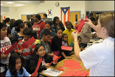 Lina Castano, aerospace PhD student, conducts a paper airplane demo with students.