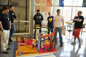 Members of the aerospace engineering team with their device.