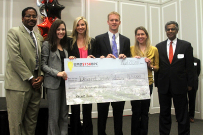 Members of the Discreet Secrete Solutions team, which won in the alumni category, pose with Deans Darryll Pines and G.