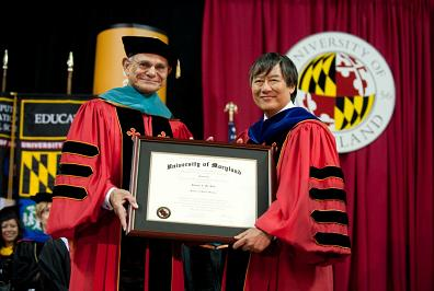 Edward St. John with UMD President Wallace Loh at the campus commencement ceremony.