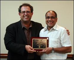 ISR Director Reza Ghodssi (L) congratulates Professor S.