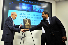 Dean Darryl Pines and Dr. Arnold Seigel shake hands at the Arnold E. Seigel Learning Center Dedication Ceremony.