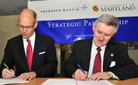 UMD VP and Chief Research Officer Patrick O'Shea (right), and Lockheed Martin Senior VP and Chief Technology Officer Ray O. Johnson (left) sign a master research agreement.