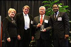 Pictured, from left to right: MIPS Director Martha Connolly; Dr. John Baras, Lockheed Martin Chair in Systems Engineering and Professor, Department of Electrical and Computer Engineering and Institute for Systems Research at the University of Maryland; John Kenyon, Senior Vice President for Engineering, Hughes Network Systems, and Clark School Dean Darryll Pines.