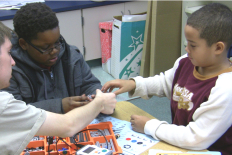 Scholars STS sophomores work with 4th grade students at Greenbelt Elementary School in the after school robotics club.
