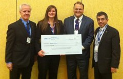 From Left to Right: Ferdinand Grosveld, Director of AIAA Region 1; Ms. Erica Hocking, MS'12, holding a $1000 check for wining the Master's Divison; Prof. Norman M. Wereley, Department Chair; and Prof. Mark Lewis, Past AIAA President and  Director of the Science and Technology Policy Institute at the Institute for Defense Analysis.