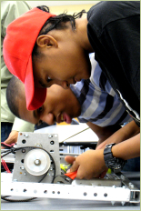 Students participate in the FIRST robotics workshop on campus, January 12, 2013.