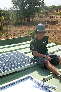 BioE senior and HHMI Undergraduate Research Fellow Jeff Rappaport on assignment with Engineers Without Borders, installing solar panels in Burkina Faso.