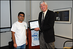 Mechanical Engineering Student ASHRAE President, Sahil Popli presents National ASHRAE President Tom Watson with Certificate of Appreciation