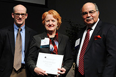 Martha Connolly, pictured in the middle, as she is inducted into the AIMBE College of Fellows.