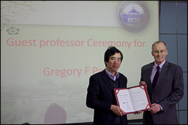 Wuhan University Vice President Qing-Yun Du (left) presenting Professor Gregory Payne with a Guest Professorship at a ceremony on March 7.