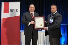 Prof. Wereley, on behalf of the TSI/UMD SAMSS Development Team, accepts the SPIE Smart Structures Product Implementation Award presented by Dr. Kevin Farinholt.