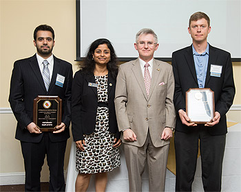 Prof. Donald DeVoe (right) and Omid Rahmanian (left) were honored at the UMD Invention of the Year Awards, and accepted his award from Vice President for Research Dr. Patrick O'Shea (center) and Office of Technology Commercialization Executive Director Dr. Gayatri Varma (center-left).