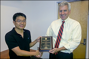 BioE graduate student Wei Wen Yu presented with the Outstanding Graduate Research Award by BioE professor and chair William E. Bentley.