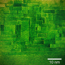 Not a brick wall. Electron microscope image of a cross section of the newly characterized tunable microwave dielectric clearly shows the thick layers of strontium titanate