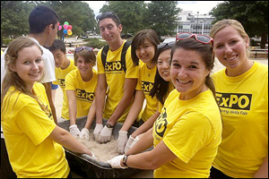 Iacangelo (second from left, of those looking at the camera) with fellow members of Engineers Without Borders at the group's annual engineering skills event, ExPO. Looking at camera, left to right: Maggie Prendergast, Iacangelo, Brian Moserowitz, Kathryn Connolly, Sarah Cho, Megan Angelini, and Sarah Niezelski.