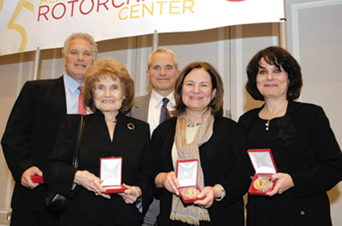 Members of the Gessow family celebrated the legacy of Alfred Gessow at the 25th anniversary of the Gessow Rotorcraft Center named in his honor in November 2007. Pictured with the Alfred Gessow Medal, which recognizes significant contributions in rotorcraft, are, from back left, sons Jory and Jody Gessow, Elaine Gessow (front left) and daughters Laura Goldman and Lisa Michelson.