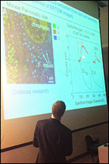 Caption: Richard Leapman, scientific director at NIH's NIBIB, presents the latest uses of electron microscopes to discover the structure of the smallest parts of cells.