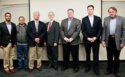 Dr. Baras (at right) with the distinguished panel of judges.