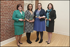 WIE Director Paige Smith, at far right, was recognized as 2014 Outstanding Exempt Staff Member by the President's Commission on Women's Issues.