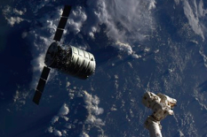 "The growing use of commercial cargo spacecraft, like Orbital Sciences Corporation's Cygnus (above), and plans for future commercial crew vehicles, have led the FAA to argue for the need for ""on-orbit authority"" to regulate their safety, particularly regarding orbital debris mitigation.  (credit: NASA)"