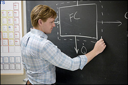 Will Gibbons (Ph.D. '14) creating a 'black box' sketch of a fuel cell system that uses methane as a fuel. The figure is part of a lecture in which he teaches students about mass balance and energy balance.