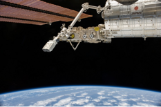 In the grasp of the Japanese robotic arm, the CubeSat deployer aboard the ISS is about to release a pair of NanoRacks CubeSat miniature satellites. NASA
