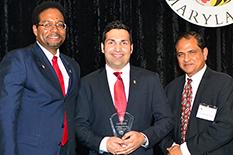 Alumni Alex Mehr (center) withDean and Nariman Farvardin Professor of Aerospace Engineering Darryll Pines (left) and Chair and Minta Martin Professor of Engineering Balakumar Balachandran (right).