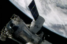 FILE- In this April 20, 2014, image made from a frame grabbed from NASA-TV, the SpaceX Dragon resupply capsule begins the process of being berthed on to the ISS. (AP Photo/NASA-TV, File)